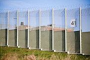 Perimeter fence at Warren Hill prison, Suffolk, England