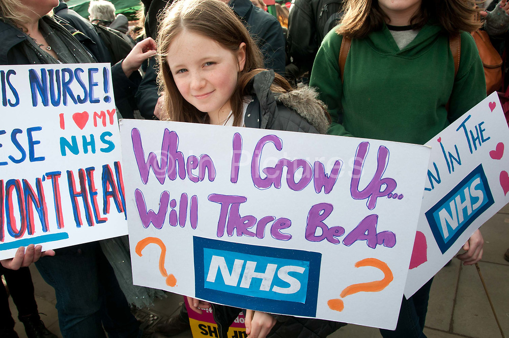 Tens of thousands of health workers, activists and members of the public protested against austerity and cuts in the NHS National Health Service on March 4th 2017 in London, United Kingdom. A young girl holds a placard with the question When I grow up will there be an NHS ?