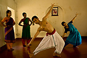 """Young indian trainee dancers  practice and train in the traditional and highly prestigious Kalakshetra school for the arts, Chennai. The school was founded in 1936 and due to its exacting and demanding schedule is considered India's formost classical dance academy of this ancient cultural art heritage that is informally known as """"temple dancing"""" and that dates back to the Natya Shastra, the 2000 year old text that lays down the principles of Indian dramatic theory and performance. Tamil Nadu, India."""