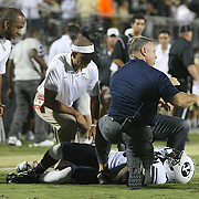 ORLANDO, FL - OCTOBER 09:  Jordan Johnson #6 of the Brigham Young Cougars lies injured on the field at Bright House Networks Stadium on October 9, 2014 in Orlando, Florida. (Photo by Alex Menendez/Getty Images) *** Local Caption *** Jordan Johnson