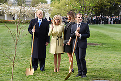 U.S President Donald Trump and First Lady Melania Trump join French President Emmanuel Macron and his wife Brigitte Macron to plant on the South Lawn of the White House a tree that the Macrons provided as a gift, a European Sessile Oak April 23, 2018 in Washington D.C . Photo by Olivier Douliery/Abaca Press