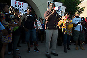 Jahi Adisa Bakari speaks during a protest at Joyce Kelly Comstock Elementary School in response to an incident with teens, including his daughter, and police officers at a community pool in McKinney, Texas on June 8, 2015.  (Cooper Neill for The New York Times)