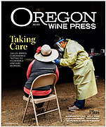 Wine magazine cover of Oregon Wine Press, documenting SALUD clinic. A medical practioner wearing appropriate PPE screening vineyard worker for COVID at Willakenzie Estate in the Willamette Valley.