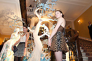 AMBER LE BON; BEN GRIMES; , Unveiling of the Dior Christmas Tree by John Galliano at Claridge's. London. 1 December 2009