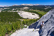 Rock climbers on Marmot Dome, Tuolumne Meadows, Yosemite National Park, California USA