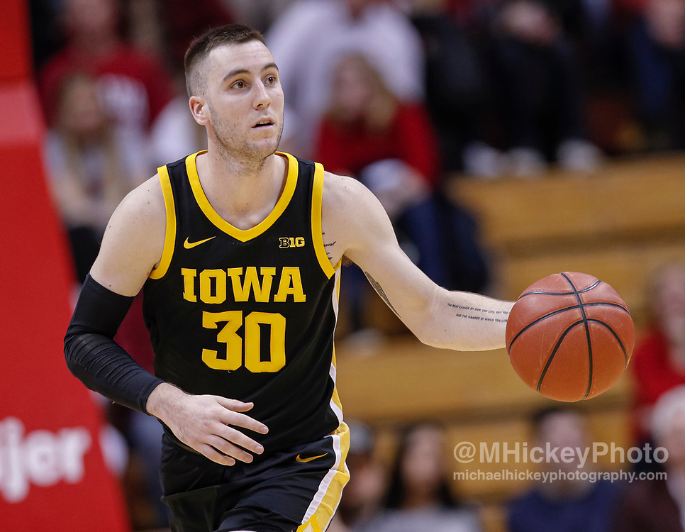 BLOOMINGTON, IN - FEBRUARY 13: Connor McCaffery #30 of the Iowa Hawkeyes brings the ball up court during the game against the Indiana Hoosiers at Assembly Hall on February 13, 2020 in Bloomington, Indiana. (Photo by Michael Hickey/Getty Images) *** Local Caption ***  Connor McCaffery