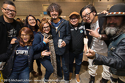 "Custom Builders Winston Yeh of Roughcraft Customs in Taiwan, Kaichiroh ""Kross"" Kurosu of Cherry's Company and Yuichi Yoshizawa of Custom Works Zon with friends at at pre-party for the Mooneyes Yokohama Hot Rod & Custom Show. Yokohama, Japan. December 5, 2015.  Photography ©2015 Michael Lichter."