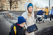 Yaroslav, 10, is out with his mother Olga, 36, to use his UNICEF video camera, near the provisional home where they live as internally displaced persons. (IDPs) Yeroslav is taking part to the UNICEF-sponsored One Minute Junior project for internally displaced persons (IDPs), carried out by the local NGO 'Ukrainian Frontiers' in the city of Kharkiv, the country's second-largest, in the east. The conflict between Ukrainian army and Russia-backed separatists nearby, in the Donbass region, have left more than 10000 dead since April 2014, including over 1000 since the shaky Minsk II ceasefire came into effect in February 2015. The approximate number of people displaced by the conflict is 1.4 million as of August 2015. Yeroslav's mother, Olga, is also a participant to a different project of 'Ukrainian Frontiers', called 'Self-Employment', first as a beneficiary, and now as a paid hotline coordinator for people seeking jobs and formation courses.