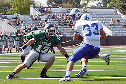 17 September 2011: Evan Hackbarth holds back P.J. Cummings for runner Steve Rivera during an NCAA Division 3 football game between the Aurora Spartans and the Illinois Wesleyan Titans on Wilder Field inside Tucci Stadium in.Bloomington Illinois.