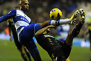 Reading's Jimmy Kebe battles for the ball with Chelsea's Ryan Bertrand. Barclays Premier league, Reading v Chelsea at the Madejski Stadium in Reading on Wednesday 30th Jan 2013. pic by Andrew Orchard, Andrew Orchard sports photography,