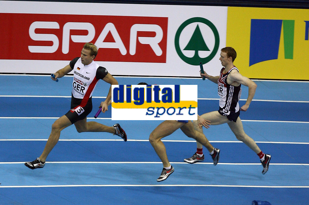 Photo: Rich Eaton.<br /> <br /> EAA European Athletics Indoor Championships, Birmingham 2007. 04/03/2007. Germanys Bastian Swillims pushes Russias Artem Sergeyenkov in the 4x400m final and Germany are disqualified - Great Britain are elevated to gold place as Steven Green right, runs the final leg