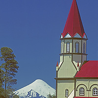 CHILE, Lakes District. Village cathedral in Puerto Varas & Volcan Osorno bkg.
