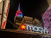 The Empire State Building stands side by side with Macy's department store in Manhattan, New York City.