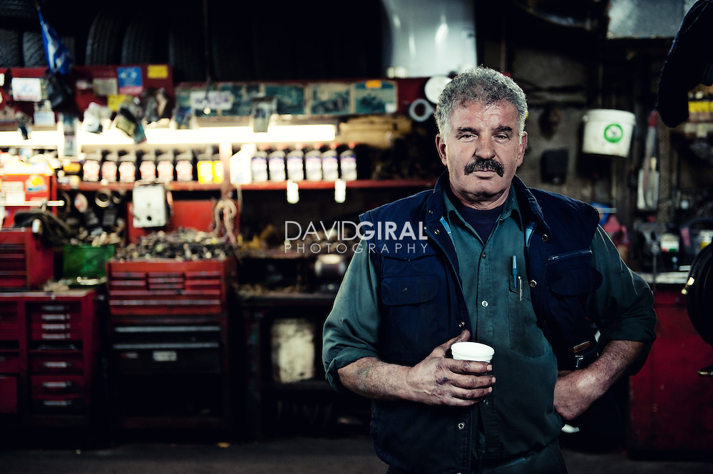 Editorial Travel Photography: Portrait of mechanic in his garage, Mile End, Montreal, Quebec, Canada