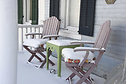 Chairs on snowy front porch