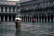 Couple walking in the rain, Piazza San Marco, Venice, Italy