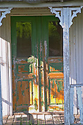 Traditional style Swedish wooden painted house. A door Fading peeling painting. A veranda. Smaland region. Sweden, Europe.