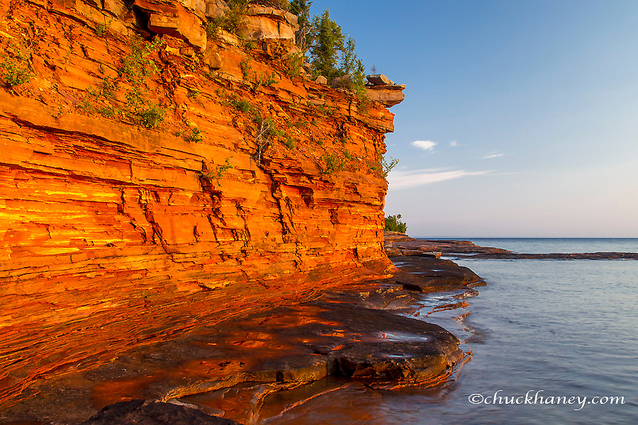 Layered sandstone cliffs and sea caves at sunrise on Devils Island in the Apostle Islands National Lakeshore, Wisconsin, USA