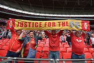 Liverpool fans hold up 'Justice for the 96' banner before k/o. The FA Cup, semi final match, Aston Villa v Liverpool at Wembley Stadium in London on Sunday 19th April 2015.<br /> pic by John Patrick Fletcher, Andrew Orchard sports photography.