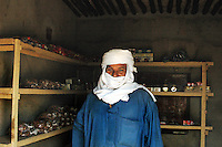Niger, Agadez, Tidene, 2007.  Rissa Ixa inside one of the only permanent buildings in Tidene. He has discovered water in over forty places.