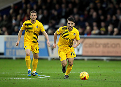 Jake Gosling of Bristol Rovers runs with the ball as Lee Mansell of Bristol Rovers watches on - Mandatory byline: Robbie Stephenson/JMP - 07966 386802 - 26/12/2015 - FOOTBALL - Kingsmeadow Stadium - Wimbledon, England - AFC Wimbledon v Bristol Rovers - Sky Bet League Two