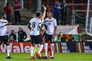 Trinidad and Tobago midfielder Kevan George gets a yellow card for a challenge on Wales midfielder Ben Woodburn during the Friendly European Championship warm up match between Wales and Trinidad and Tobago at the Racecourse Ground, Wrexham, United Kingdom on 20 March 2019.