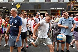 "© Licensed to London News Pictures. 07/07/2018. LONDON, UK. England fans in the capital celebrate the England national team's 2-0 victory against Sweden in the quarter-final match of the World Cup in Russia.  Jubilant fans in Charing Cross Road stop passing traffic chanting ""Football's Coming Home"".  The annual Pride London event is also taking place in the area with happy rainbow clad Pride participants keen to celebrate as well.  England will face the winner of home team Russia or Croatia in the semi-final.  <br />   Photo credit: Stephen Chung/LNP"