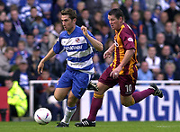 © Peter Spurrier/Sportsbeat Images <br /><br /> 04/10/2003 - Photo  Peter Spurrier<br />2003/04 Nationwide Football Div 1 Reading Town FC v Bradford City FC.<br />Reading's Nicky Forster evades Dean  Windass's tackle as he moves in the the area