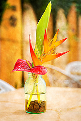 A tropical floral centerpiece on a table at a diner while vacationing in Mai, Hawaii