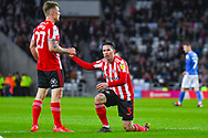 Max Power of Sunderland (27) helps up Bryan Oviedo of Sunderland (3) during the EFL Sky Bet League 1 first leg Play Off match between Sunderland and Portsmouth at the Stadium Of Light, Sunderland, England on 11 May 2019.