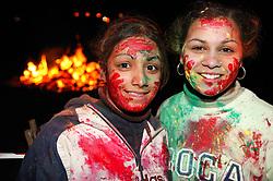 Young girls enjoying the Hindu Holi festival; celebration of colours,