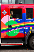 A rainbow coloured 'Pride in Lancashire' fire engine at the start of the Manchester Pride Parade on the 25th August 2018 in Manchester in the United Kingdom. The Manchester Pride is an annual LGBT pride festival and parade held each summer in the city of Manchester, England.