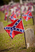 Confederate flags on the graves of soldiers killed in the U.S. Civil War during Confederate Memorial Day May 10, 2011 in Charleston, South Carolina.  South Carolina is one of three states that marks the day as a public holiday.