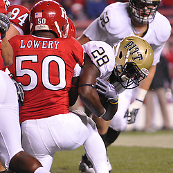 Oct 16, 2009; Piscataway, NJ, USA; Rutgers linebacker Antonio Lowery (50) and defensive tackle Scott Vallone (94) tackle Pittsburgh running back Dion Lewis (28) during first half NCAA football action in Pittsburgh's 24-17 victory over Rutgers at Rutgers Stadium.