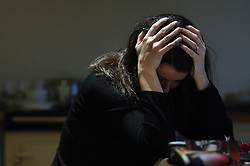 "PICTURE POSED BY MODEL. File photo dated 08/11/07 of a person showing signs of stress. A union has warned work-related stress is a ""growing epidemic"" after new figures showed an increase in working days lost because of the problem."