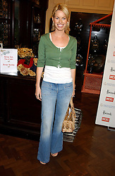 CAROLINE HABIB at a fashion show featuring designs by Diesel Kid's FW05 collection held in The Georgian Restaurant at Harrod's on 1st September 2005.  Proceeds from the event went to the Graet Ormond Street Hospital.<br /><br />NON EXCLUSIVE - WORLD RIGHTS
