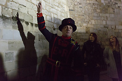 © Licensed to London News Pictures. 23/10/2013. London, UK. The Yeoman warder, Kevin Paul Kitcher, leads a twilight tour at the Tower of London which gives visitors a unique after hours view of the UK's most visited historic attraction. The first Twilight Tour at the Tower of London will take place on 3 November 2013 and they will then take place every Wednesday during November, then January, February and March in 2014.Photo credit : Vickie Flores/LNP