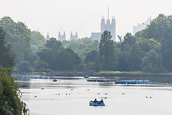 Licensed to London News Pictures. 02/07/2021. London, UK. Members of the public enjoy the warm sunshine this morning on the Serpentine in Hyde Park, London with highs of 25c today. However, weather forecasters predict showers for the next 5 days with temperatures down to 18c for London and the South East as the unpredictable British weather continues. Photo credit: Alex Lentati/LNP