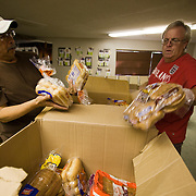 Volunteers at Second Chance Ministry prepare bags of food to be given to those in need.