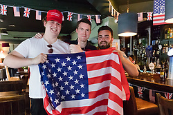 © Licensed to London News Pictures. 13/07/2018. London, UK.  Guests pose with a US flag at the Donald Trump special relationship evening and welcome party held at  the Trump Arms Pub (formerly known as Jameson Pub) in Hammersmith, west London. The pub has been decked out with American flags and banners celebrating Donald Trump's arrival in the UK..  Photo credit: Vickie Flores/LNP