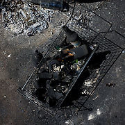Charred cocktails molotov are seen near an administrative building set alight, the previous day, during deadly clashes between separatists armed groups and the Ukrainian Army over the control of key buildings in the city.