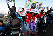 Teleia Hymes (center) and her daughter Elaiya Robinson, 2, wait with other families for the crew of the USS Rodney M Davis to disembark after the frigate's final six-month deployment, Friday at Naval Station Everett, December 19, 2014.  The ship will be decommissioned on January 26.