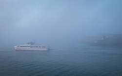 © Licensed to London News Pictures. 30/12/2016. Portsmouth, UK.  The Wightlink catamaran sails out of the foggy entrance of Portsmouth Harbour en route to the Isle of Wight. People on the South Coast have woken up to foggy weather this morning, 30th December 2016. Photo credit: Rob Arnold/LNP