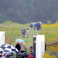 A light rains falls as family members of the victims of the crash of United Airline Flight 93 walks the path leading to the actual crash site at the Flight 93 National Memorial on the 13th Anniversary of the 911 terrorist attacks on September 11, 2014.  UPI/Archie Carpenter