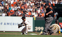 Oct 3, 2021; San Francisco, California, USA; San Francisco Giants second baseman Tommy LaStella (18) prepares to tag out San Diego Padres first baseman Jake Cronenworth (9) as he tries to stretch his single into a double during the seventh inning at Oracle Park. Umpire is Joe West. Mandatory Credit: D. Ross Cameron-USA TODAY Sports