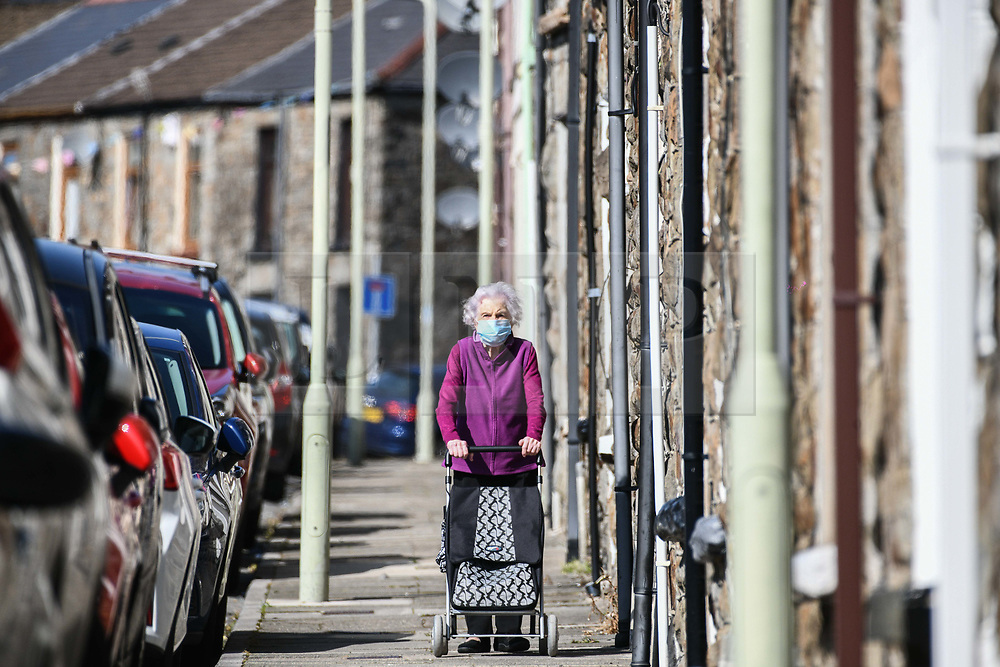 © Licensed to London News Pictures. 17/09/2020. Rhondda Valley, UK. Local resident, Pauline Warman aged 89 makes her way along a traditional terraced street in the town of Treorchy in the Rhondda Valley which will go into local lockdown today after a spike in the coronavirus infection rate in the borough of Rhondda Cynon Taff in south Wales.. Photo credit: Robert Melen/LNP