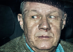"""© Licensed to London News Pictures. 01/12/2017. Ashford, UK. First Secretary of State DAMIAN GREEN seen through a rainy car window as he leaves his Kent home. The findings of an inquiry in to the conduct of MP Damian Green are due to be released, following allegations that """"extreme"""" pornography was found on his computer during a police raid in 2018. Green was already under investigation for allegedly propositioning a former Tory activist, Kate Maltby. Photo credit: Peter Macdiarmid/LNP"""