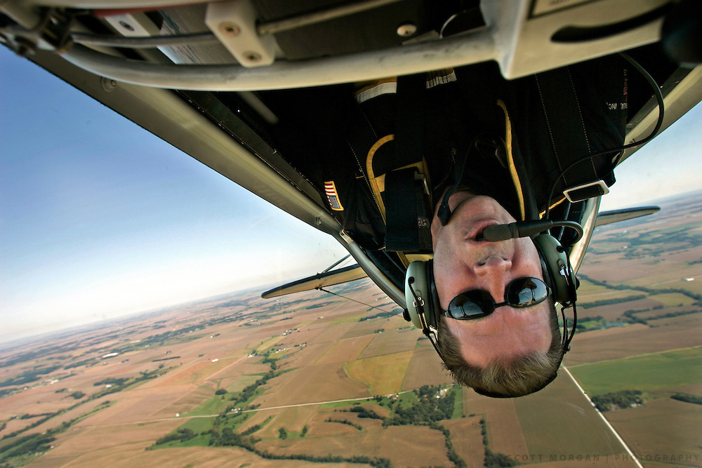 Pilot Jon Melby of Chandler, Ariz., flys upside down in his Pitts S2B airplane Friday, Sept. 17, 2004, on a practice run over Illinois before the Burlington Air Show on Saturday. Scott Morgan   The Hawk Eye