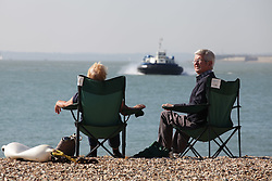 © Licensed to London News Pictures. 02/10/2015. Southsea, Hampshire, UK. A couple enjoying themselves on the beach in the sunny weather in Southsea, Hampshire today, 2nd October 2015. The weekend weather is set to be dry and fine day in the south of England. Photo credit : Rob Arnold/LNP