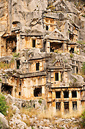 Pictures & images of the ancient Lycian rock cut tombs town of Myra, Anatolia, Turkey. .<br /> <br /> If you prefer to buy from our ALAMY PHOTO LIBRARY  Collection visit : https://www.alamy.com/portfolio/paul-williams-funkystock/myra-lycian-tombs-turkey.html<br /> <br /> Visit our CLASSICAL WORLD HISTORIC SITES PHOTO COLLECTIONS for more photos to download or buy as wall art prints https://funkystock.photoshelter.com/gallery-collection/Classical-Era-Historic-Sites-Archaeological-Sites-Pictures-Images/C0000g4bSGiDL9rw